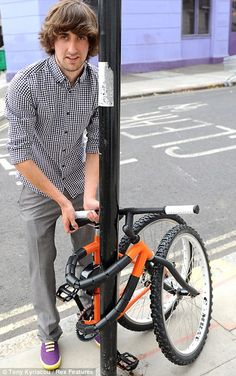 21 year old design student Kevin Scott showed off a space-age bike that wraps around a lamp post so it can be locked-up safe. gumby bike!