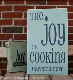 The Joy of Cooking Happens Here Distressed Vintage Style Sign. $75.00, via Etsy.