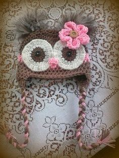 This listing is for an adult size owl hat in the colors shown. Brown, pink and tan with brown and tan feather poofs and a flower with a wood button in