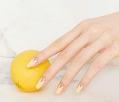 Not one for big patterns and fancy designs? Try this dainty mani with just a tiny triangle cutout along the moons of your nails. It's as simple and festive as those yellow peeps.