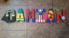 Superhero letters hand painted by theStarvingPainter on Etsy