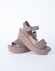 These Chunky Flatform Sandals can be paired with just about anything! Comes in a taupe or black color of your choice. Made from a faux suede and leather material. Features a single band, ankle straps