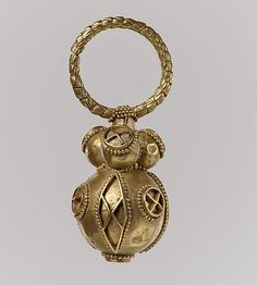 One of a pair of Gold Earrings, 550–650. Culture: Avar