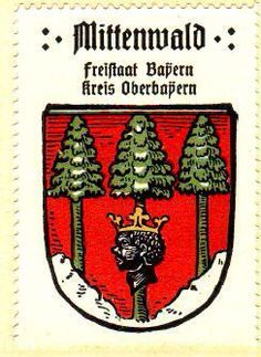 MITTENWALD, located in the state of Bayern in the district (Kreis) : Garmisch Partenkirchen. The arms were granted on June 20, 1407 by Berthold von Wehingen, bishop of Freising (1382-1410). The arms are canting, being Middle-forest. The crowned Moor's head is the arms of the bishops of Freising.