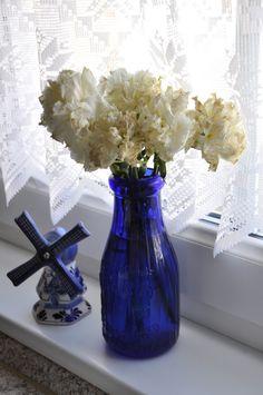delft and antique blue glass milk bottle
