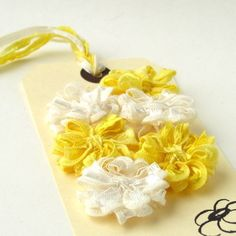 Small Flowers in yellow and ivory ribbon, mixed set of 6 appliques £6.00