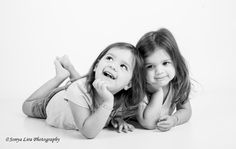 2 1/2 year old twin sisters by Sonya Lira Photography Manvel, Texas Natural photo session just playing in the studio.