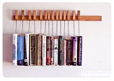 Book rack - The book rests on a small wooden plate, and the waxed cotton string it hangs from also serves as a bookmark.