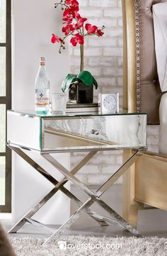 Add style and storage to your bedroom with this beautiful modern-meets-glam-style nightstand. Choose between a champagne gold-plated finish and a chrome finish to complement the other elements in your space. The beveled mirror top and sides catch your eye when you walk into your room.