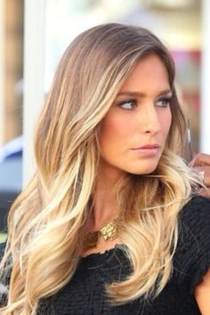 Great balayage colour a darker blonde smudging into lighter ends, works great with the layers & texture in the haircut
