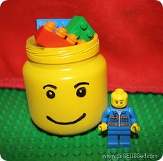 Lego Head Jars out of baby food jar. Party Favor, room decoration - by obSEUSSed. What a great idea for Awesome DIY party favor for a lego birthday party.