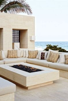 OUTDOOR LIVING ROOM: Made of niwala limestone from Spain, the outdoor living room's seating is topped by cushions clad in a Ralph Lauren Home fabric.