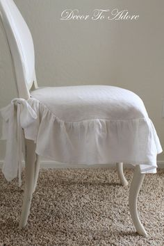 DIY:  Slipcover made from linen dish towels.   Instructions aren't very detailed, but it is a very cute slipcover!