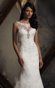 You'll be the most beautiful bride in this Blu by Mori Lee 5109 wedding gown. This flawless gown is made of chantilly lace with a fit and flare skirt. The bodice is embellished with beaded lace appliques. This style can also be ordered in 55 inches or 58 inches lengths, subject to availability.