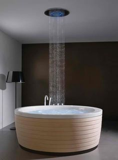 deep soaking tub with a rainforest shower