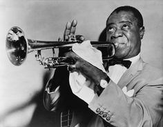 Louis Armstrong  Louis Armstrong was a jazz musician that sang vocals and played various instruments, including the trumpet as pictured. He performed solo and with other performers right up until his accidental death in 1971. Satchmo's image was immortalized in this photo.