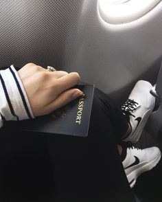 Travel wear - striped shirt, leather leggings, and Nike air max thea