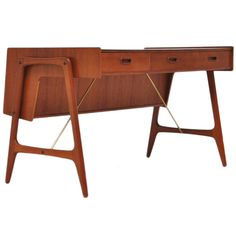 Danish teak orrganic desk with brass details