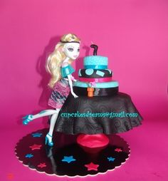 Monster High Cake-  You could make this mini cake using different sized cookies and a doll table.