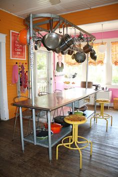 a pink and orange kitchen.. now that's a lot of color!