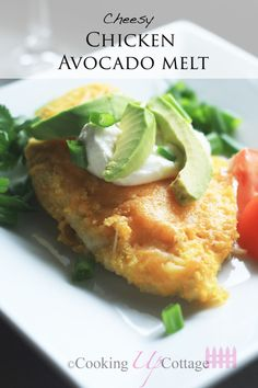 Cheesy Chicken Avocado Melt - This chicken breast recipe features a crispy, cornmeal breading.  And when you add the cheese, sour cream, tomatoes, onions, and most importantly the avocado, the flavors go through the roof.