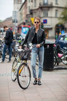 models off duty leather jacket jeans  bicycle