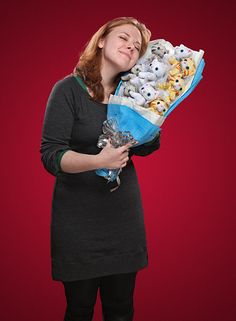 """Plush Kitten Bouquet. Bouquet of 9 plush kittens in a beautiful wrap, ready for gifting. t's your own personal 'Itteh Bitteh Kitteh Committeh'. Each kitten attaches to a """"stem"""" via its collar and can be detached. $40"""