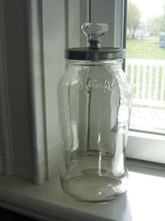 DIY Apothecary Jar: pasta jar, painted lid, add glass knob, glue short thrifted candlestick & creatively fill!