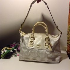 "Coach Madison Leather Julianne Brand: Coach Model: 18135 Material: Other Solid Color: White Condition: Used -very good Size: Large 100% Authentic!!!  Creed #12947  Zipper closure  1 zipper and 2 multi-functions pockets  Material: C fabric with leather trim and accents.   No hangtag  (L)12""x9"" (H)x6""D  Short Strap:4""  Long strap:10""  In gently use. There are discoloartion on the handle.There are minimal worn spots on the edges and minimal stains on the lining.Can be cleaned. Coach Bags…"