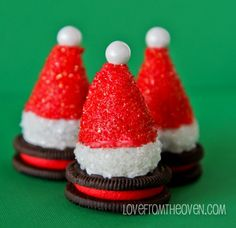 Santa Hat Cookies made with Oreos and Oreo Truffles!  These are adorable and no baking required!  Love this easy recipe, perfect for Christmas cookie platters.  Would also be darling on top of a cupcake!
