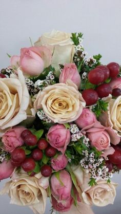 Antique and spray roses woth hypericum berries and thrip