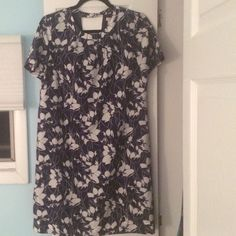Floral Short Sleeve Summer Dress JCrew Factory Cute shift style dress for summer. Beautiful detailing. Blue and white flowers. Cut out back detailing. Size 8. 100% Polyester 100% Lined Polyester J. Crew Dresses