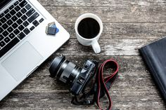 Laptop with digital camera and a coffee cup. - Laptop with digital camera and a coffee cup on old wooden table Laptops For Photographers, Lightroom, Recover Deleted Photos, Cheap Coffee Maker, Photography Camera, Photography Sites, Photography School, Photography Workshops, Photo Today