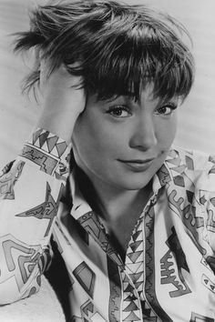 """1959 Shirley MacLaine - Southern Hair the Year You Were Born - Southernliving. The six-time Oscar-nominated actress who was born in Richmond, Virginia alludes to the end of the 1950s with her chic pixie cut that may have even inspired Twiggy herself in the 1960s. Trendsetting, she made her Hollywood debut with a cropped cut in the Hitchcock film The Trouble With Harry in 1955. Probably one of our all-time favorite roles was the bitter, wise-cracking """"Ouiser"""" Boudreaux in Steel Magnolias."""