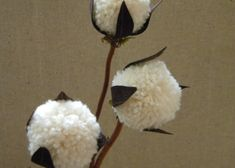 """homework: creative inspiration for home and life: Sew and Tell: yarn pom poms  How to....""""I glued the pom pom to a twig, added a tiny bit of moss and cut leaves out of brown fabric."""""""