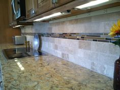 travistene back splash, completed kitchens. | Backsplash is 3×6 antique white tumbled travertine subway tile with a ...