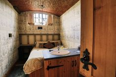 The Old Court in Temple Cloud: former courthouse with jail cell bedrooms and prisoners' trapdoor for sale Log Burning Stoves, Jacuzzi Bath, Jail Cell, Sauna Room, Unusual Buildings, Spa Rooms, Unusual Homes, Round House, Luxury Holidays
