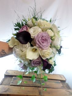 Small cascading wedding bouquet in creams, lilacs and purples. Designed by Florist ilene, Hamilton, NZ Cascading Wedding Bouquets, Flowers Delivered, Lilacs, Corsage, Gift Baskets, Hamilton, Beautiful Flowers, Great Gifts, Floral Wreath