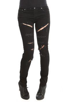 Los jeans son de color negro. Jeans se vería bien con una chaqueta de cuero. Ellos son finas y tiene muchos agujeros.