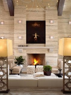 Wall of travertine; I like the bumped out fireplace idea for being able to run cables up to a TV.