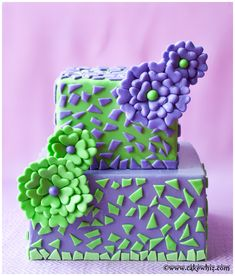 Purple and green cake with cute FANTASY FLOWERS made with only 2 cutters! Tutorial included. From cakewhiz.com