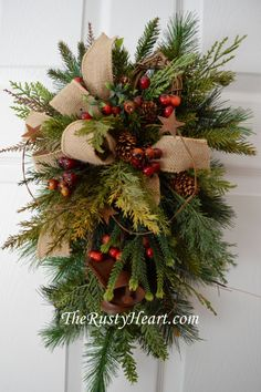 Rustic Christmas Swag with Rusty Bells by TheRustyHeart on Etsy                                                                                                                                                                                 More