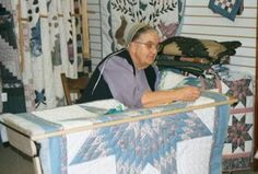 """An Amish quilter works on a quilt for """"the English."""""""
