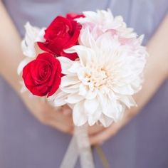 Love the pop of red in this blush bridesmaid bouquet!