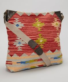 Add a bit of bohemian beauty to any outfit by slipping on this stylish crossbody bag. A duo of interior pockets adds practicality to this pleasant piece.17'' W x 14'' H x 4.5'' D22'' shoulder dropMaximum strap length: 46'' 100% cotton dhurrie