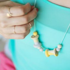 Combine natural wood beads with a bit of paint for a quick and simple necklace! #diyjewelry