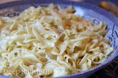 A dish of cabbage and onions pan sauteed in butter with cooked egg noodles stirred in.