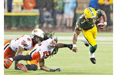 B.C. Lions Korey Banks and Joe Burnett miss the tackle on Edmonton Eskimos Hugh Charles during first half action in Edmonton.