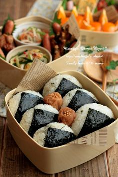 Onigiri しらす大葉おにぎり.  Japanese food made from white rice formed into triangular or oval shapes and often wrapped in nori (seaweed). Traditionally, an onigiri is filled with pickled ume (umeboshi), salted salmon, katsuobushi, kombu, tarako, or any other salty or sour ingredient.