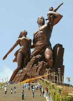 """""""African Renaissance Movement"""" is a 60-ft tall  bronze statue overlooking the Atlantic Ocean in Senegal & designed by a Senegalese architect....awesome!"""